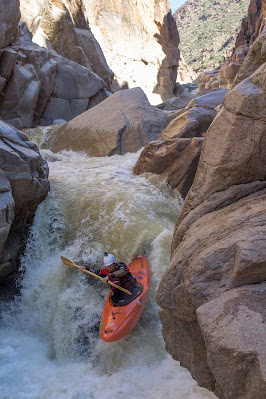 Chris Baer finishing up the last canyon, photo by Evan Stafford, Hell's Gate wilderness whitewater Arizona, orange zet kayak wood paddle kokatat wrsi helmet