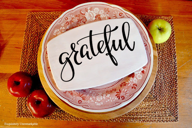 Wooden Grateful Sign For Fall on a plate and one a placemat with applies around it