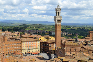 The Torre del Mangia towers over Siena's Piazza del Campo