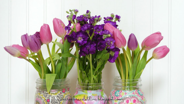 pink and purple tulips in Mason jar vases
