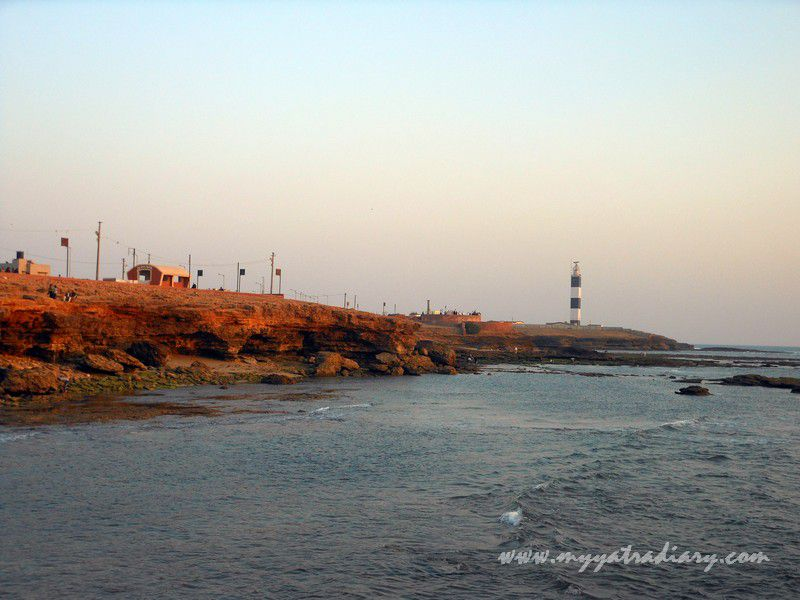 Lighthouse during sunset hour at Bhadkeshwar Shiv Temple, Dwarka, Gujarat