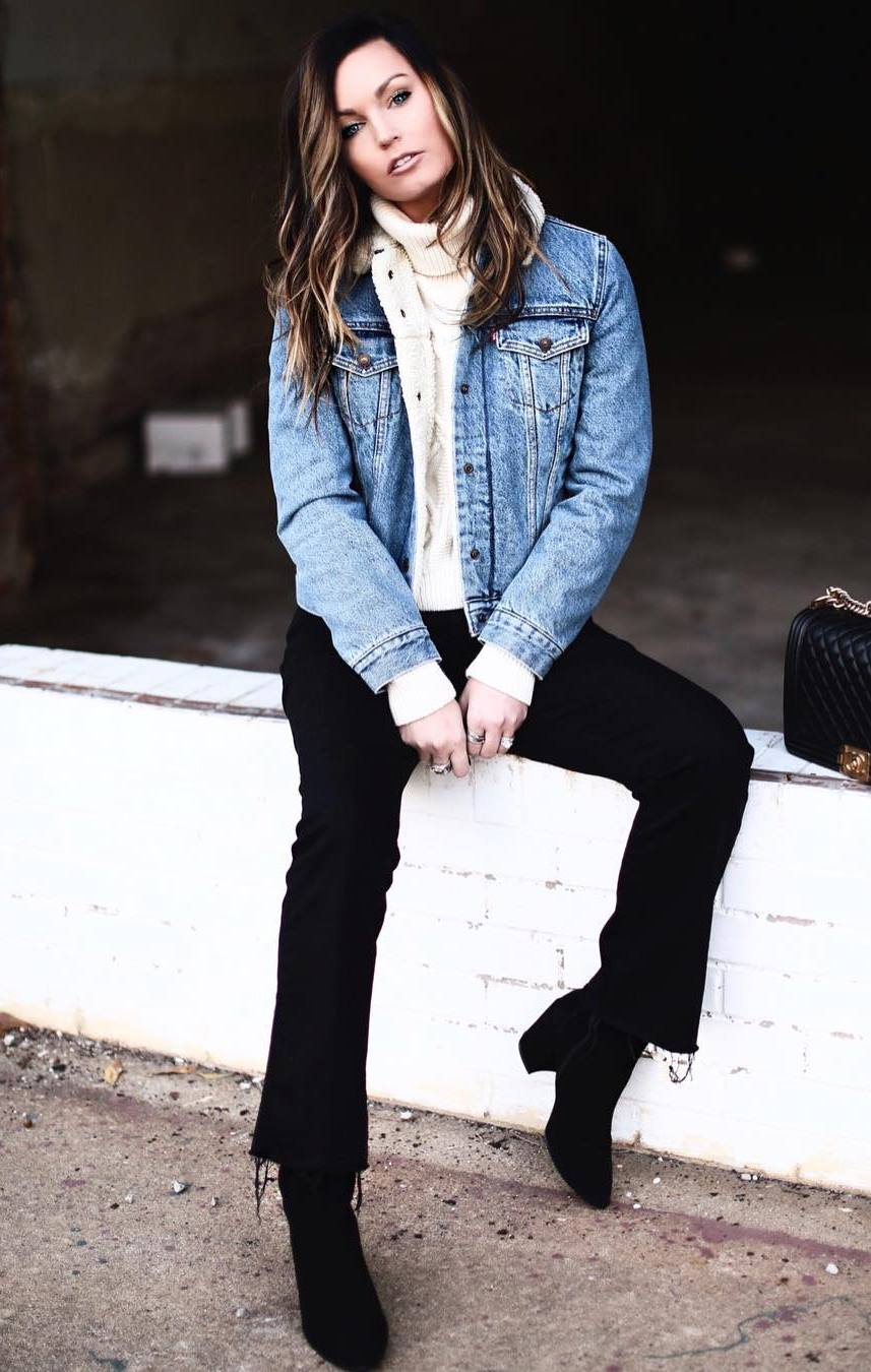 what to wear with a denim jacket : white sweater + black jeans + boots