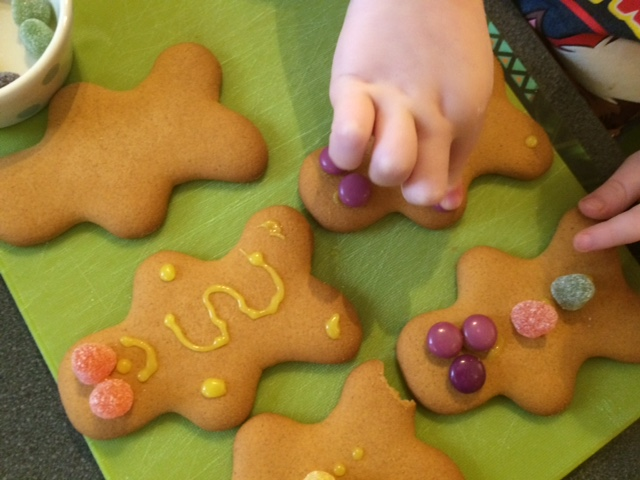 Toddler decorating gingerbread men