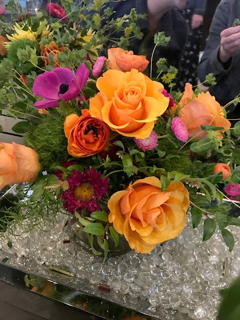 Orange purple and pink floral arrangement