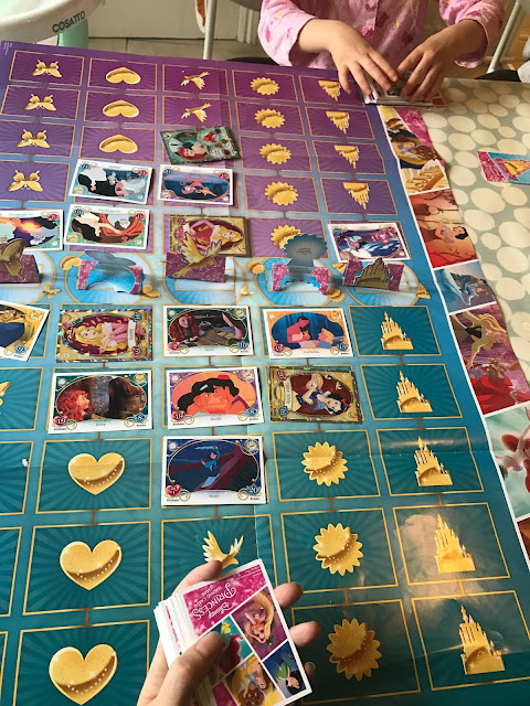 Side 2 of the Disney Princess Trading Card Game game mat with cards in place and the stand up cards across the middle