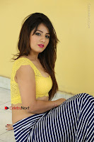 Cute Telugu Actress Shunaya Solanki High Definition Spicy Pos in Yellow Top and Skirt  0401.JPG