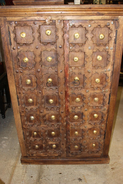 https://www.mogulinterior.com/antique-indian-handcarved-wooden-armoire-with-grounding-energies.html