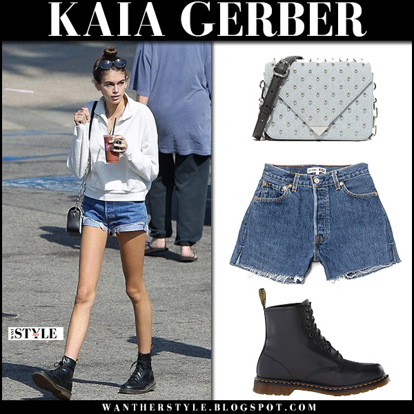 Kaia Gerber in denim shorts, black army boots and white sweater model style october 8 2017