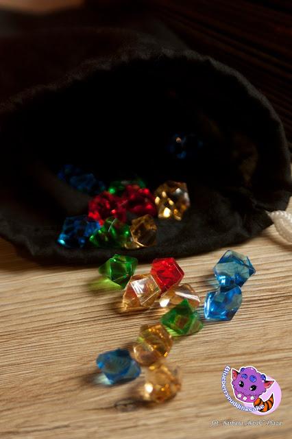 Sprawę rozwiązana za pomocą kryształów, każdy kolor odpowiada odpowiedniej ilości punktów.