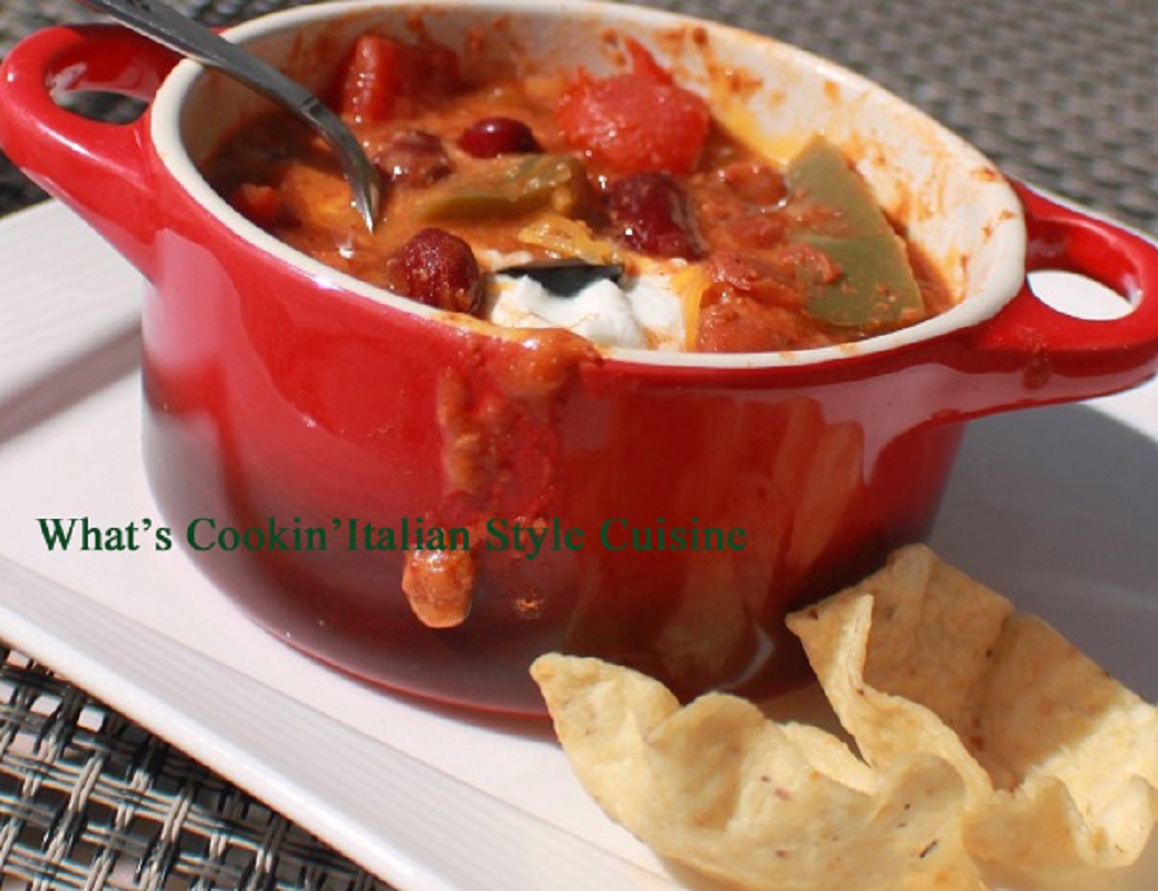 Slow Cooker Guinness Cheesy Chili  in a red crock