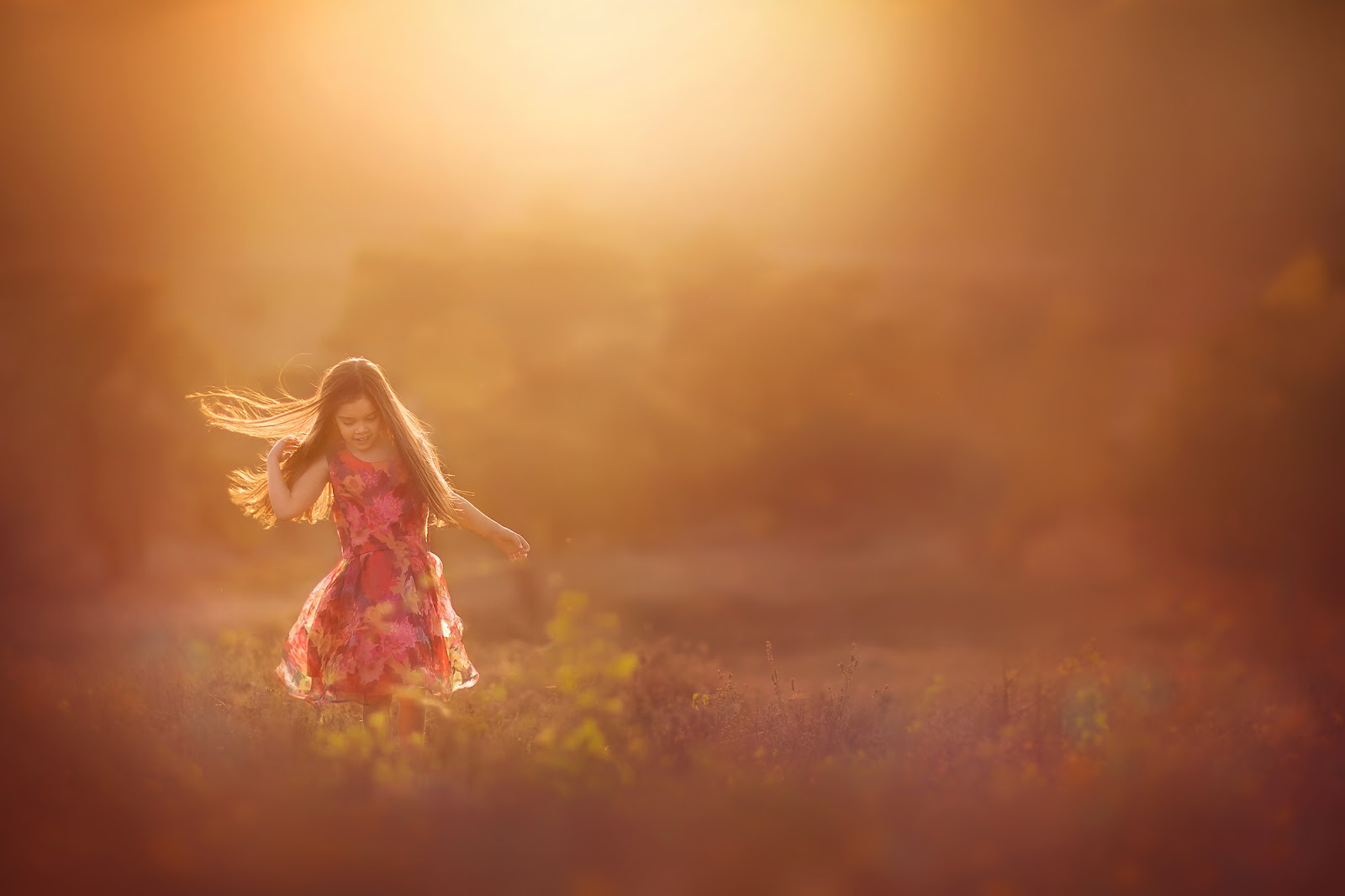 Canon golden hour portrait of a little girl in a red dress dancing in the forest by Willie Kers