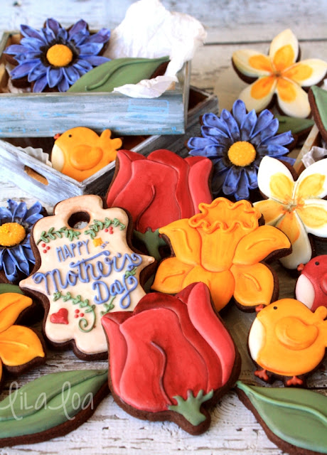 decorated spring flower sugar cookies - daffodils, daisies, tulips, and plumeria