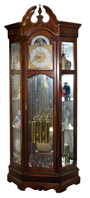 A tall cherry grandfather clock with mirror backing and glass shelves.