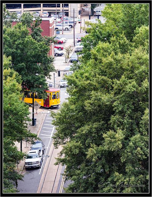 Little Rock Streetcar 408 Is Seen Through the Trees In Little Rock