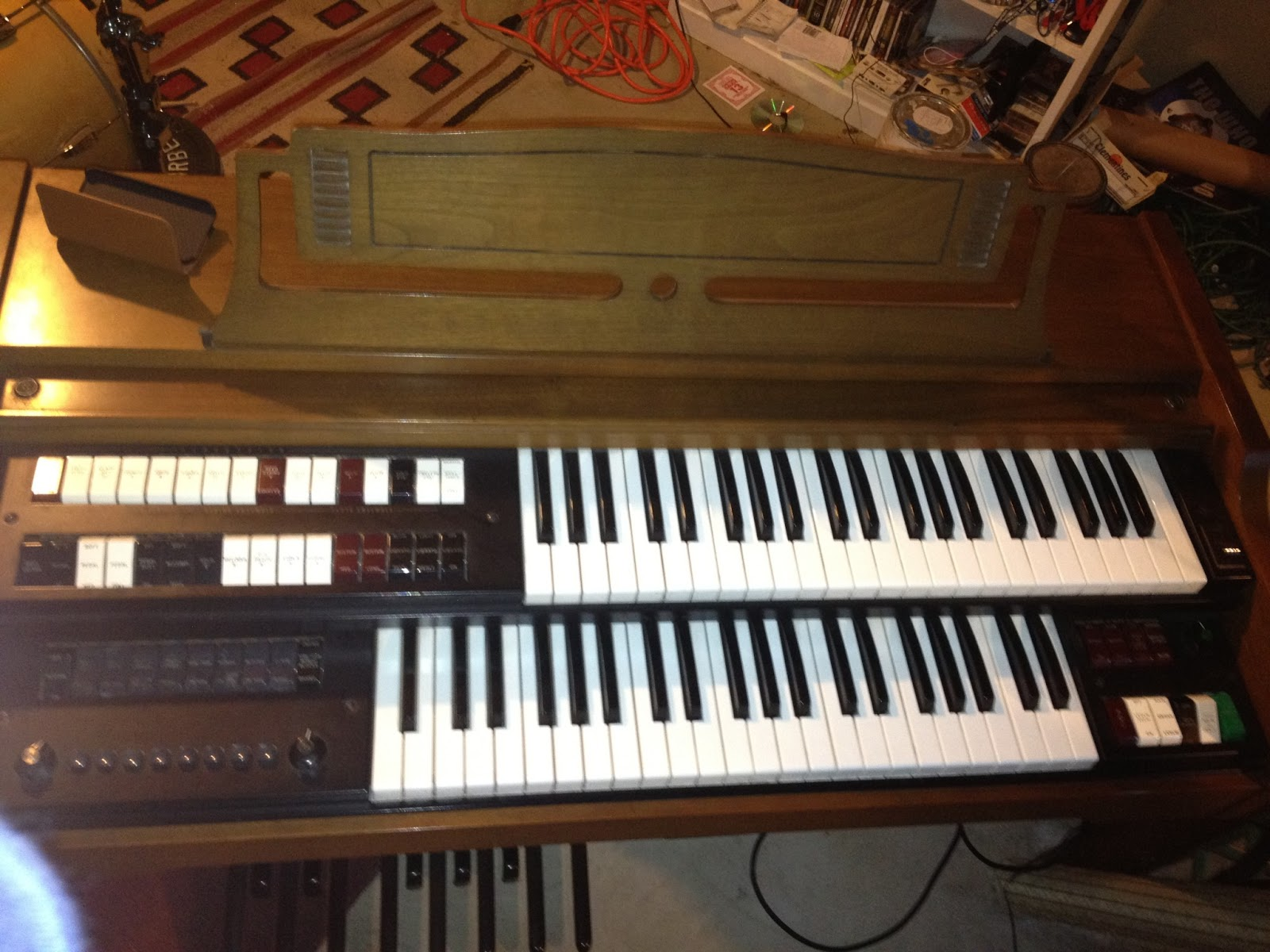 This overhead photo shows the whole organ layout. It is a fairly typical  spinet organ, with two 44-note manuals, a 13-note pedalboard, and an  expression ...