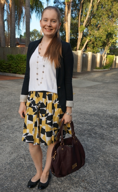 mustard pleated print a-line skirt white tee jersey blazer business casual autumn | awayfromblue
