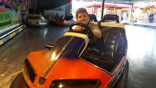 Dan Jon riding a Bumper Car
