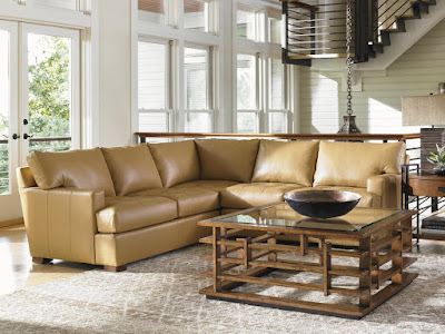 cream colored leather sofa by Tommy Bahama