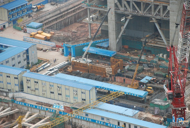 Photo of steel sections being prepared for lifting to the top floors