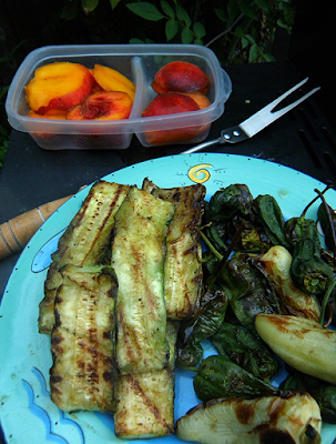 Plates of grilled veggies and fruit