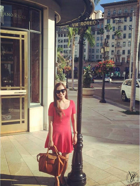 lady in coral at rodeo drive