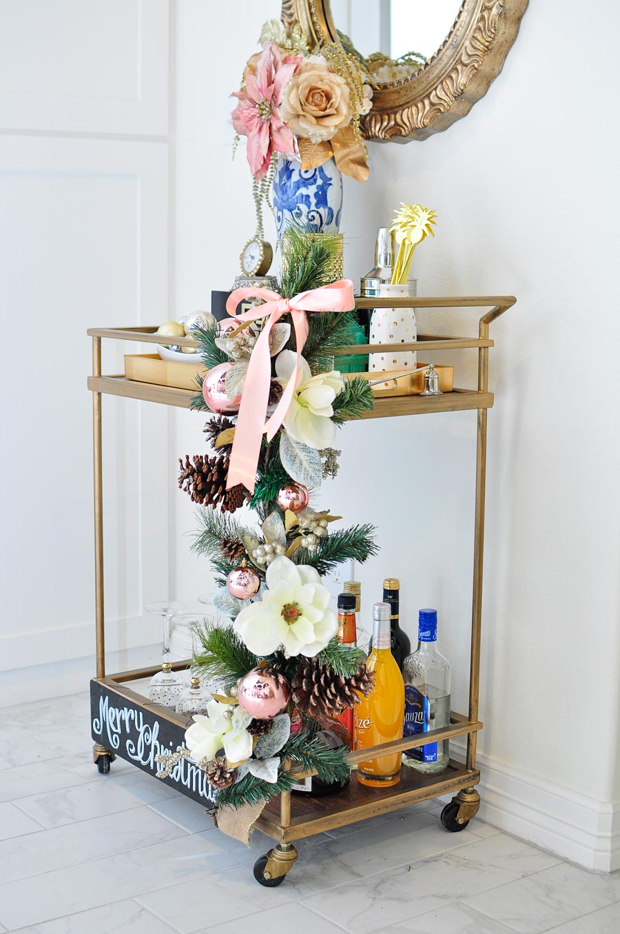 Decorate your bar cart like a pro for the holidays with these simple tips and ideas. Love the blush pink and gold chinioiserie vibe!