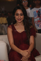 Pragya Jaiswal in Stunnign Deep neck Designer Maroon Dress at Nakshatram music launch ~ CelebesNext Celebrities Galleries 117.JPG