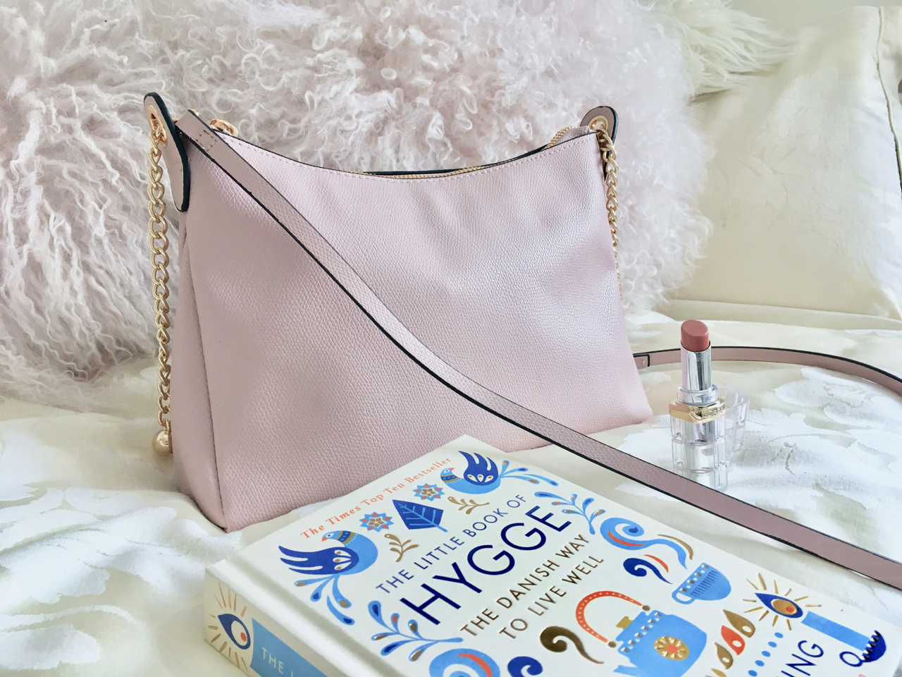 Pink H&M bag, lipstick and Hygge book