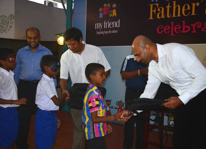 Handing over gifts to children of the 'My Friend' project by Graham Labroy, Julian Bowling & Hussain Sadique,