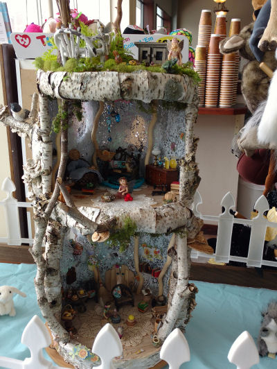 fairy house made of birch bark and moss