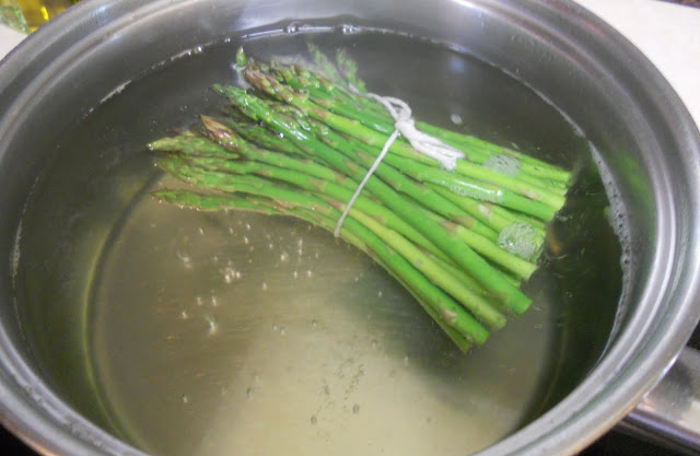 Asparagus tied with kitchen twine for blanching.