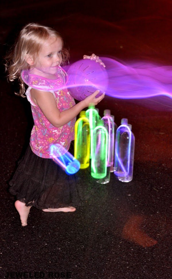 Night bowling- a super fun activity for Summer.  The glowing ball and pins are easy to make, too!