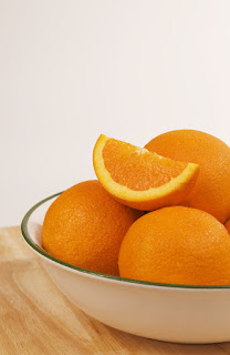 a bowl filled with oranges; taken by: Amanda Mills; source: freestockphotos.biz