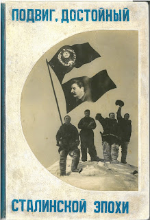 Image of four scientists on a mount of ice holding up two flags. On flag has Stalin's image on it.