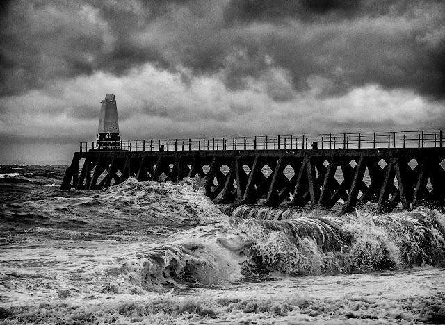 Photo of wild waves battering Maryport pier