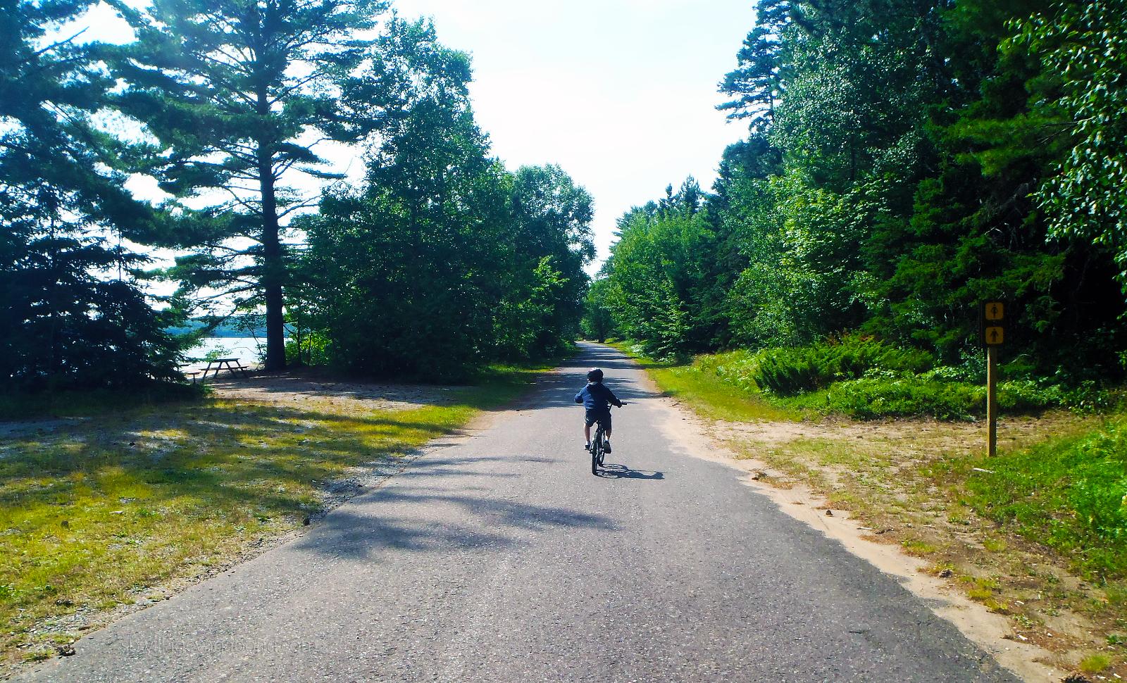 Bike riding alongside Lake Superior at Batchawana Bay Provincial Park.