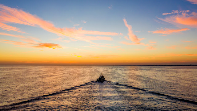 Boat sailing into the sunset - DJI Mavic 2 Pro - Image by Matt Dugard