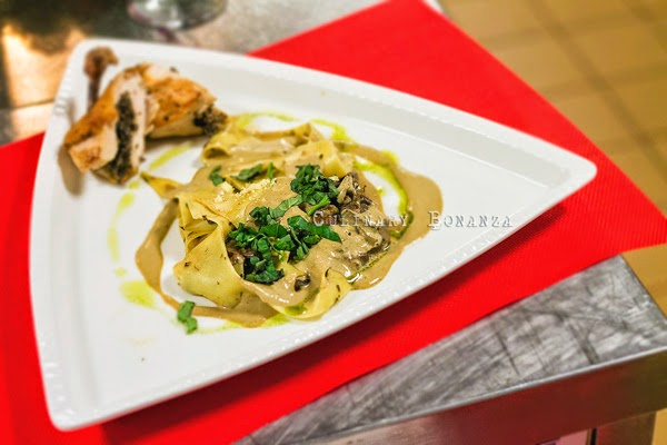 Homemade Parpadele with creamy sauce and breaded chicken fillet stuffed with mushrooms
