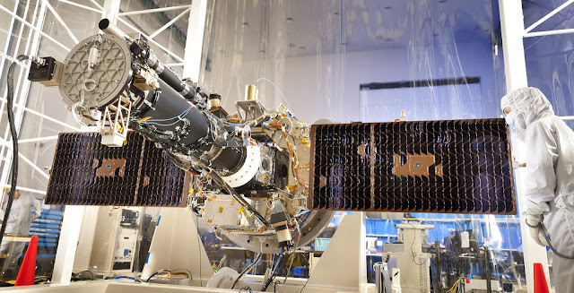 NASA's Interface Region Imaging Spectrograph (IRIS) with solar panels, seen here in the clean room at the Lockheed Martin Advanced Technology Center in Palo Alto, where it was designed and built. Photo Credit: NASA/Lockheed Martin