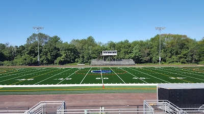 new turf field install underway at the high school