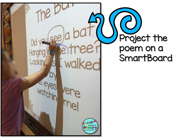 Use the Smartboard to project Halloween sight word poems.