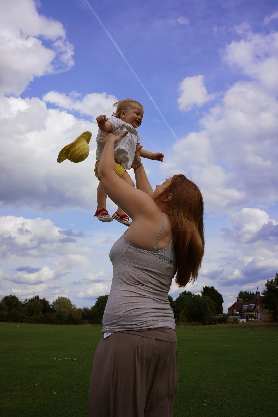 mum throwing baby in the air