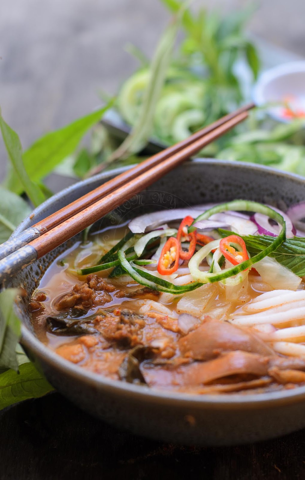 Asian fish soup serve with rice noodles image