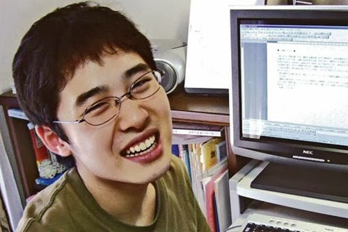 Naoki Higashida pictured smiling by his computer.