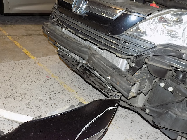 Dented bumper on Honda CR-V before repairs at Almost Everything Auto Body