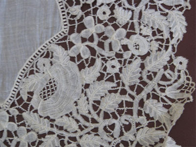 close-up of the hand made lace edging on a cotton handkerchief