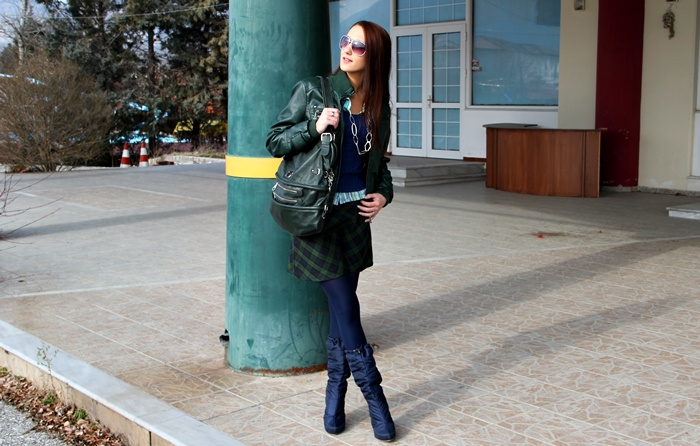 dark green leather biker jacket and purse