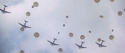 Paratroopers jumping from Dakotas