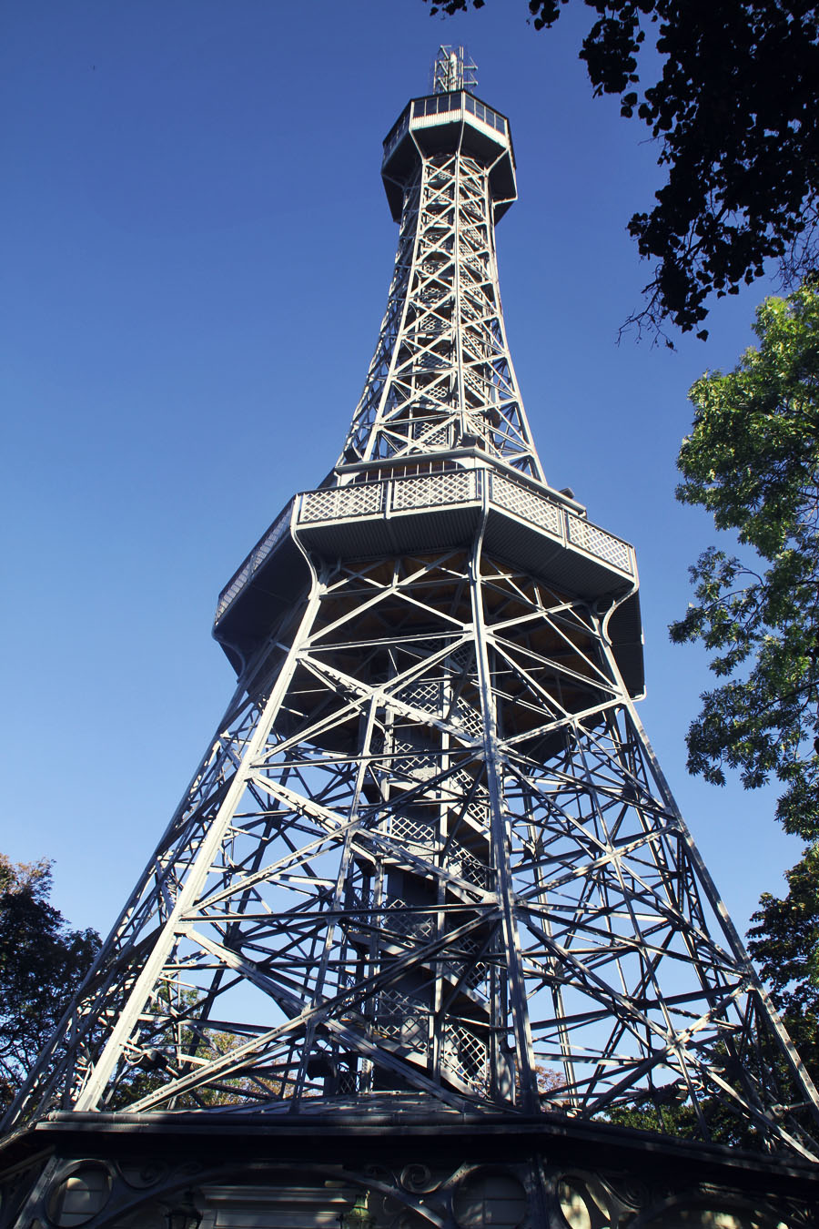 Petrin Tower Prague, Petrin Lookout Tower in Prague, The Petrin Lookout tower  is a 60 metre high steel framework that resembles the Eiffel tower albeit smaller and has a different structure. Despite, it being situated on a hill gives it a higher altitude than the Eiffel tower.