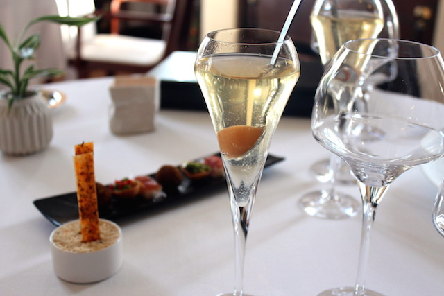 Champagne cocktail and nibbles